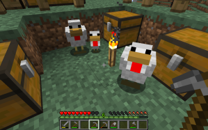 A Minecraft scene featuring two chickens and a baby chicken looking at the camera. There are three chests around them, and they are contained in a pit