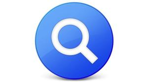 Spotlight logo—a blue circle with a white outline of a magnifying glass inside